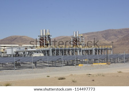 a solar power plant on a warm summer day - stock photo