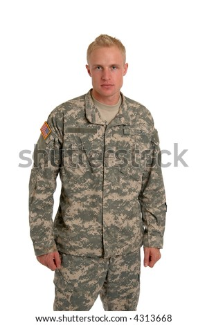 A soldier standing in combat fatigues - stock photo