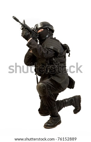 A soldier with a rifle isolated on white - stock photo