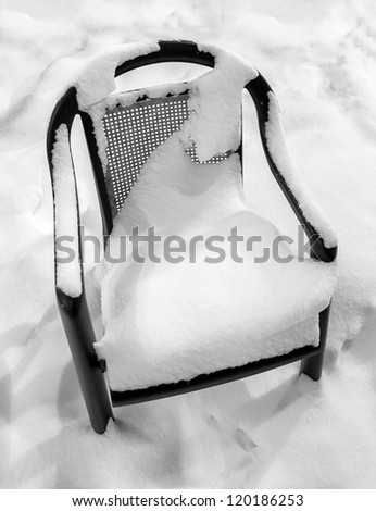 A solitary chair after a snowfall in Les Deux Alps - France - stock photo