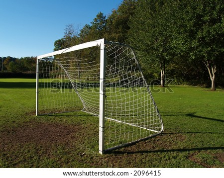 A solitary soccer goal at the end of the field - stock photo