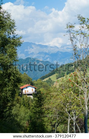 a solitary white house photographed at Piani d'Erna (part of the Alps) near Lake Como in Italy - stock photo