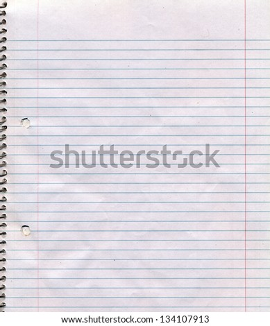 A somewhat dirty and wrinkled page of a spiral bound lined notebook. - stock photo