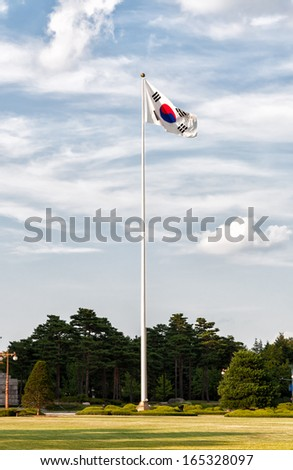 A South Korean flag flaps in the wind outside of the National Assembly of South Korea in Seoul. - stock photo