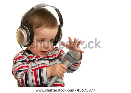 A speaking toddler with headphones and microphone; isolated on the white background - stock photo