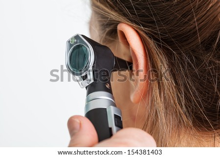 A special tool put inside a patient's ear - stock photo
