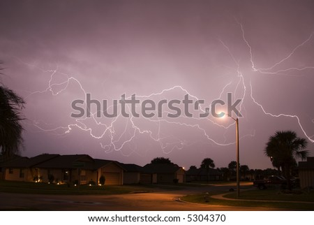 A spectacular display of cloud to cloud lightning during a late summer night storm in Central Florida - stock photo