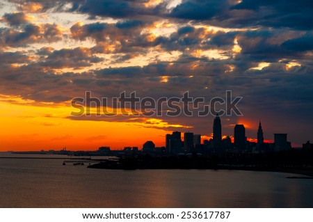 A spectacular sunrise over Cleveland Ohio produces intriguing lighting effects - stock photo
