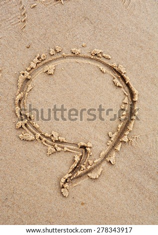 A speech bubble drawn out on a sandy beach - stock photo