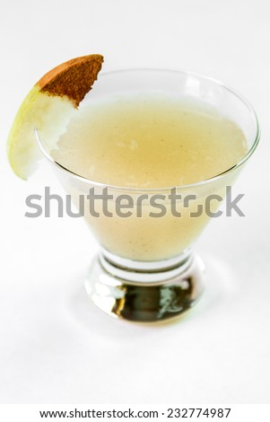A spicy pear cocktail against a white background - stock photo