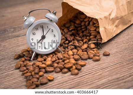 a spilled black coffee bag in spotlight - stock photo