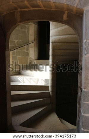 A spiral staircase in a medieval castle. - stock photo
