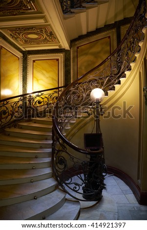 A spiral staircase in the house of the Eliseev brothers. - stock photo