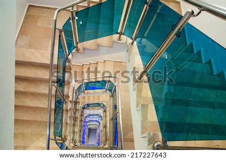 A spiral staircase multistory building - stock photo