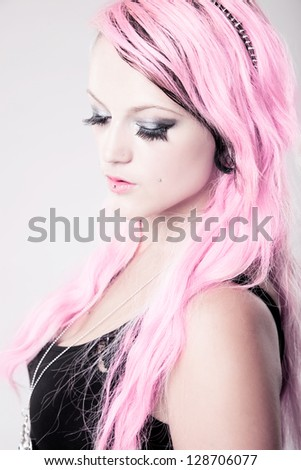 A splash of pink - girl with pink hair - stock photo