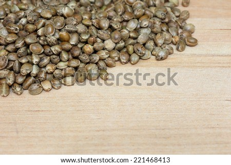 A spoon full of raw hemp seeds - stock photo