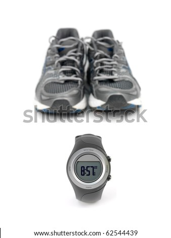 A sports watch and sports shoes isolated against a white background - stock photo