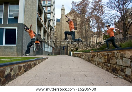 A sportsman does a parkour jump over a gap - stock photo
