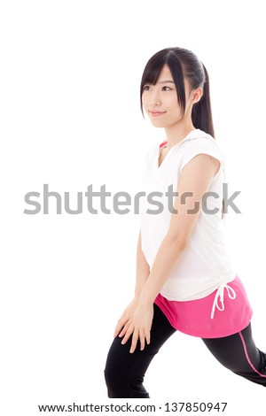 a sporty young asian woman exercising on white background - stock photo