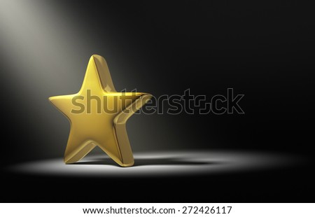 A spotlight brightly illuminates a single gold star on a dark background.    - stock photo
