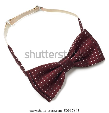 a spotted red bow-tie on white - stock photo