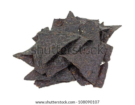 A stack of blue crisp corn tortilla chips. - stock photo