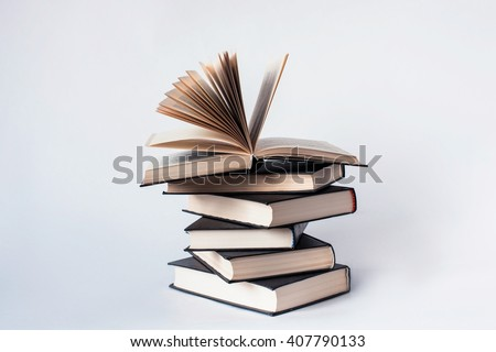 A stack of books lying on a white background, learning, education, study - stock photo