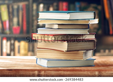 A stack of books on the shelf - stock photo