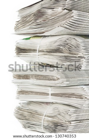 A stack of bundled freshly printed newspapers - stock photo