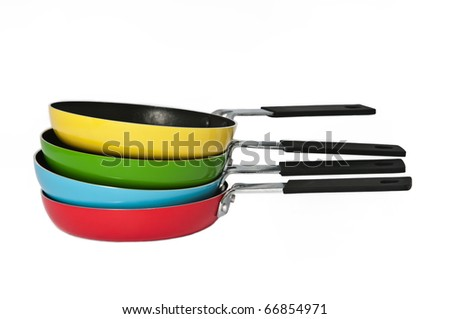 A stack of colorful frying pans on a seamless white background - stock photo