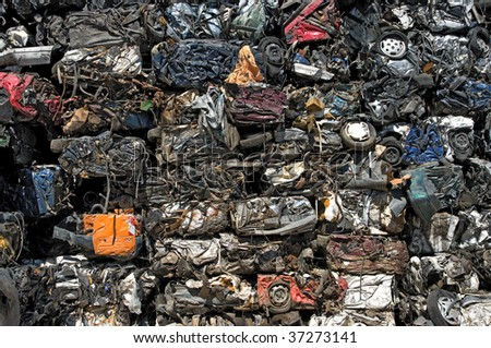 A stack of crushed cars for metal recycling - stock photo