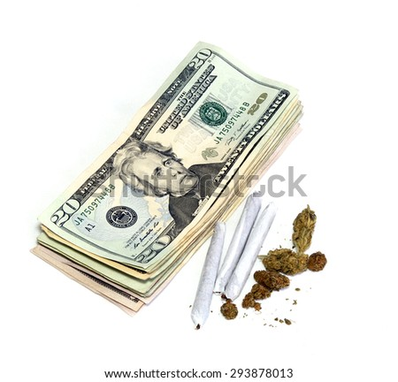 A stack of 20 dollar US bills is shown beside a cluster of marijuana pot buds and three joints, over white. - stock photo