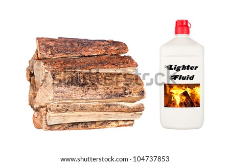 A stack of dry, fresh firewood isolated on white with a bottle of lighter fluid. - stock photo