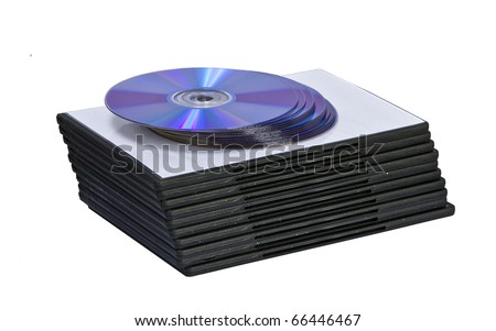 A stack of DVD or CD cases with DVD's - stock photo