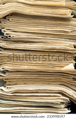 A stack of newspapers for recycling. - stock photo