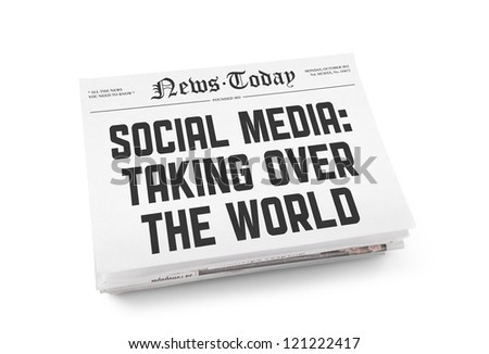 "A stack of newspapers with headline ""Social media: Taking over the world"". Isolated on white. - stock photo"