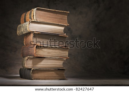 A Stack of old books. - stock photo