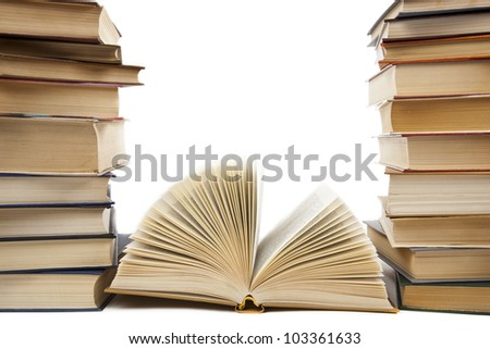 a stack of old books on a white background - stock photo