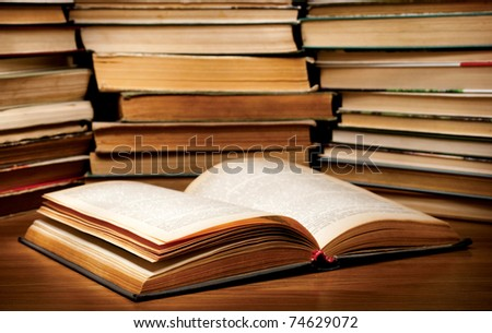 A stack of old books on the table. - stock photo