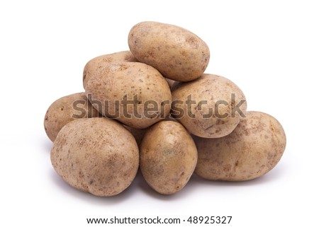 A stack of ordinary raw potatoes.  On white background. - stock photo