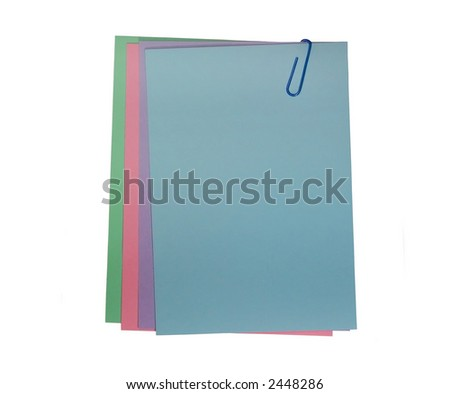 A stack of pastel papers attached with a paper clip. - stock photo