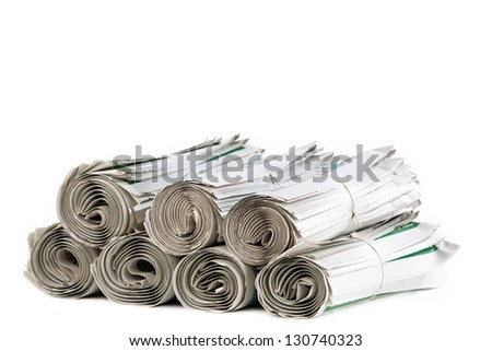 A stack of rolled up newspapers ready to be delivered - stock photo
