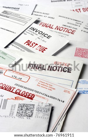A stack of statements and invoices indicating a past due status on the accounts. Vertical shot. - stock photo