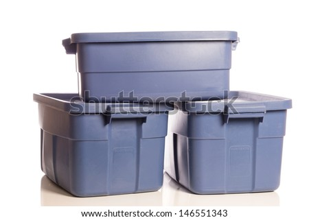A stack of three blue plastic storage tubs - stock photo