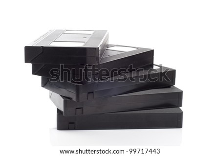 A stack of video cassettes isolated on white background. - stock photo