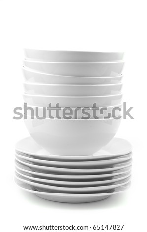 a stack of white dishes en soup bowls isolated on white - stock photo