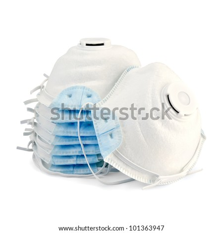 A stack of white with blue detail disposable respirators isolated on white background - stock photo