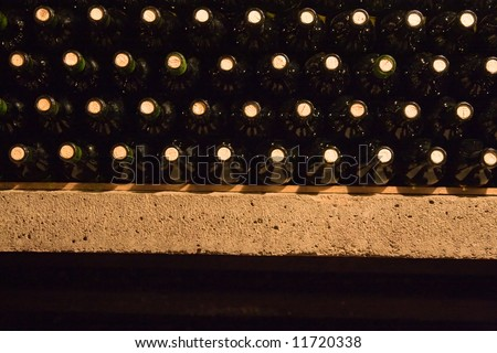 a stack of wine bottles in the shelf - stock photo