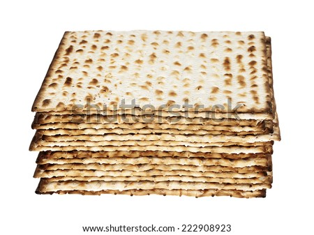 A stacked pile of Jewish Matzah bread, the substitute for bread on the Jewish Passover holiday, isolated on white background. - stock photo