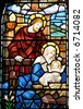 A stained glass window of Mary, Joseph and baby Jesus. - stock photo